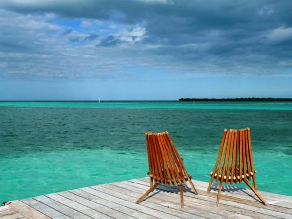 Beach chairs, beach scene, blue water