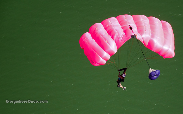Base Jumper Parachutes Over Water