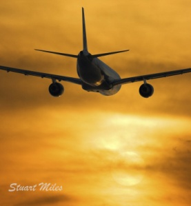 Airplane Flying into Sunnset