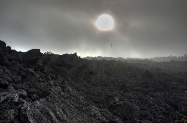Sun Mist and Volcanic Landscape