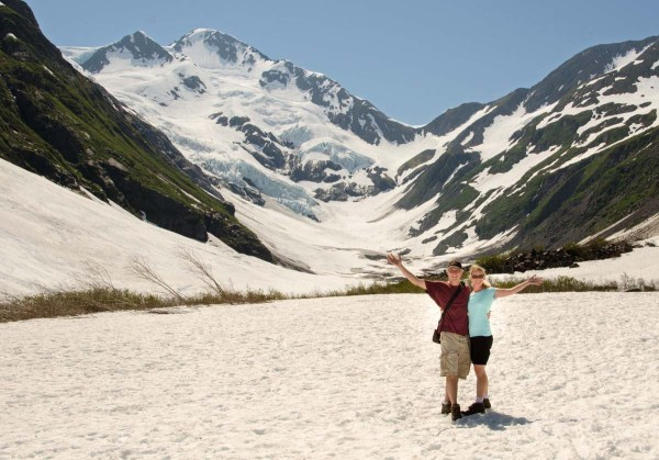 Hiking on snow in shorts and a t-shirt in sunny Alaska