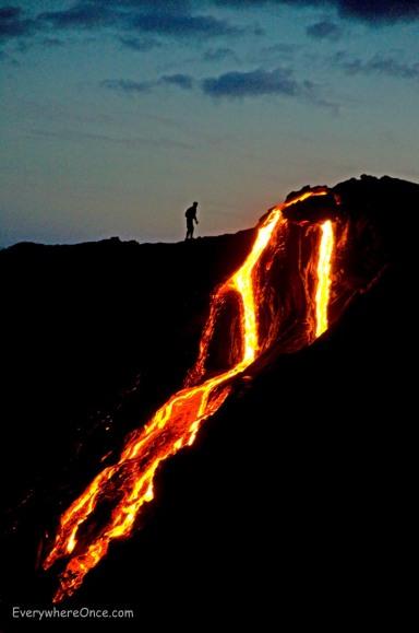 Guy walking near a lava flow