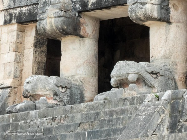 Serpent head statues at Chichen Itza